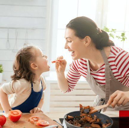 Woman feeding a girl