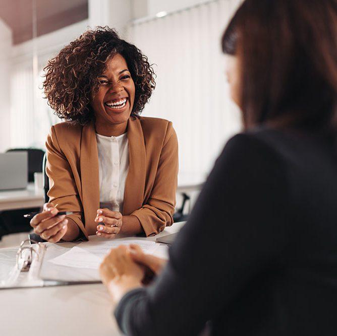 Luma_ Female financial advisor consulting a client